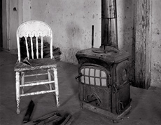 Chair and Stove, Shakespeare, New Mexico. Black and white ghost town photograph