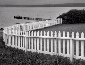 Fence and Pier, 1976. Port Townsend, Washington
