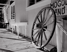Wagon Wheel, Front Porch,  Mogollon, New Mexic.  Limited edition black and white photograph