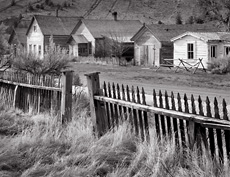 Fence and buildings, Bannack, MT. Black and white ghost town photograph
